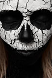 Beauty Woman with Skull on her Face royalty free stock photography