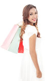 Beauty woman smiling while carrying shopping bags. Portrait of Beauty woman smiling while carrying shopping bags isolated on white background Stock Photography