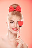 Beauty woman smiling with red heart.Valentines Day Stock Image