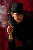 Beauty woman smoking in the night Stock Photo