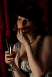 Beauty woman smoking in night Stock Photography