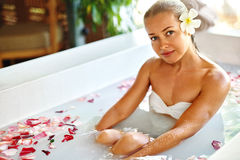 Beauty Woman Spa Body Care Treatment. Flower Bath Tub. SkinCare. Beauty Woman Spa Body Care Treatment. Closeup Portrait Of Beautiful Smiling Model Girl Relaxing royalty free stock images