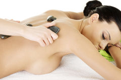 Beauty woman in spa. Stone massage. Royalty Free Stock Photography