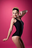 Beauty woman sport pin-up style on pink Stock Photos