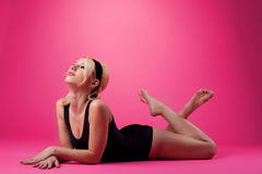Beauty woman sport pin-up style on pink Stock Photo