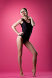 Beauty woman sport pin-up style stand on pink Stock Photos