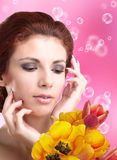 Beauty Woman with Spring Flower Stock Images