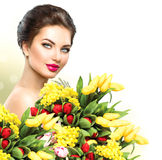 Beauty woman with spring flowers bouquet stock photos