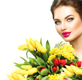 Beauty woman with spring flowers bouquet Royalty Free Stock Image