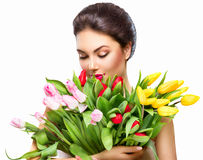 Beauty woman with spring tulip bouquet Royalty Free Stock Photography