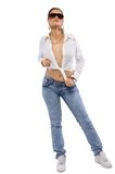 Beauty woman stand in jeans and shirt Stock Images