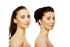 Beauty woman standing behind her friend. Royalty Free Stock Photo