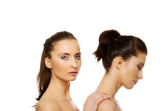 Beauty woman standing behind her friend. Stock Photos