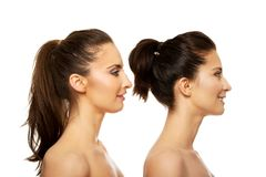 Beauty woman standing behind her friend. Stock Images