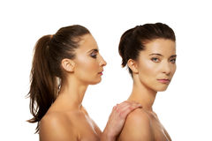 Beauty woman standing behind her friend. Stock Image