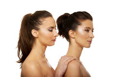 Beauty woman standing behind her friend. Royalty Free Stock Image