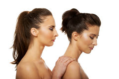 Beauty woman standing behind her friend. Stock Photography