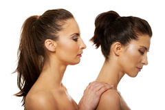 Beauty woman standing behind her friend. Royalty Free Stock Images