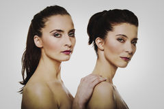 Beauty woman standing behind her friend. Beauty women with make up standing behind her friend Royalty Free Stock Photos