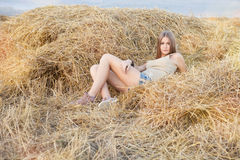 Beauty woman in the straw in field Stock Photography