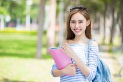 Beauty woman student. Smile happily in the school stock photo