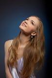 Beauty woman studio portrait look at light Stock Photography