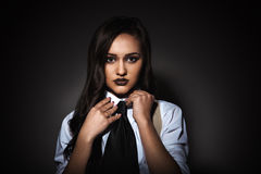 Beauty woman in studio shooting with only one spot-light Stock Photos