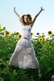 Beauty woman in sunflower Stock Image