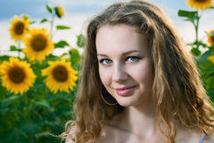 Beauty woman in sunflower Stock Images