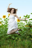 Beauty woman in sunflower Stock Photography
