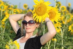Beauty woman and sunflowers Stock Photos