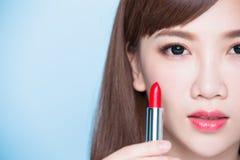 Beauty woman take lipstick Stock Photos