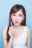 Beauty woman take lipstick Royalty Free Stock Images