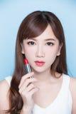 Beauty woman take lipstick royalty free stock image