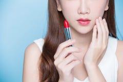 Beauty woman take lipstick Royalty Free Stock Photo