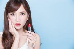 Beauty woman take lipstick Stock Image