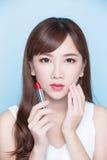 Beauty woman take lipstick Stock Photo