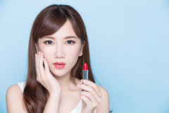 Beauty woman take lipstick Royalty Free Stock Photos