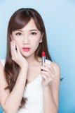 Beauty woman take lipstick Stock Images