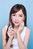 Beauty woman take lipstick Royalty Free Stock Photography