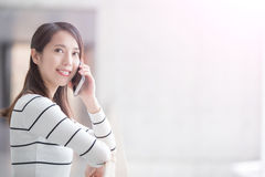 Beauty woman talk on phone. And look somewhere in hongkong Royalty Free Stock Images