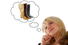 Beauty woman thinking on new boots Royalty Free Stock Photos