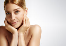Beauty woman touching her face Stock Image
