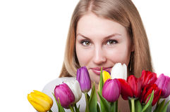 Beauty woman with tulips Stock Photos