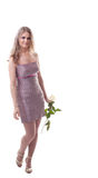 Beauty woman walk and smile with rose Stock Image
