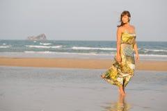 Beauty woman walking along a beach Royalty Free Stock Photo