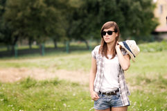 Beauty woman walking through meadow. Beauty young woman walking through meadow Royalty Free Stock Photography