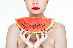 Beauty woman with watermelon, red lips, Nail Polish Stock Image