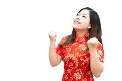 Beauty woman wear cheongsam and feel excited with chinese new year on white background. She wears bracelets, gold rings and flower stock images