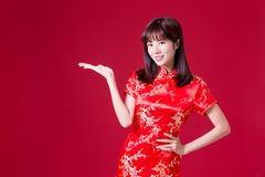 Woman show something with cheongsam stock images